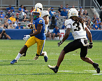 Pitt running back AJ Davis (21) looks to elude UCF defensive back Aaron Robinson (31). The Pitt Panthers defeated the UCF Knights 35-34 in a football game played at Heinz Field, Pittsburgh, Pennsylvania on September 21, 2019.