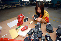 Workers at Jet Shoe Manufacturing in  Houjie Town, Donguan, China.  Jet is struggling to find workers and ir running at half capacity and employing may older men rather than young women. As the economy changes and Chinese labour gets more expensive, factories are cosing leaving ghost towns behind them.<br /> <br /> MUST CREDIT PHOTO BY RICHARD JONES/SINOPIX