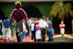 Victor Espinoza walks alone to the paddock before the Best Pal Stakes at Del Mar Race Course in Del Mar, California on August 5, 2012.
