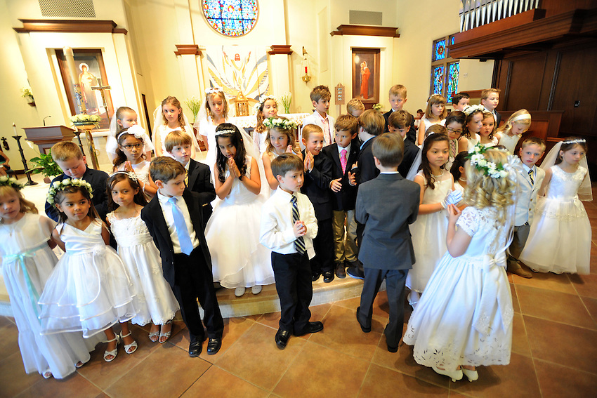 Students from Holy Spirit School celebrate their First Communion at Holy Spirit Catholic Church in Sacramento, California, Saturday, May 11, 2013. (photo by Pico van Houtryve)