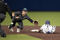 Michigan State Spartans shortstop Marty Bechina (2) dives for a throw as Michigan Wolverines baserunner Jordan Brewer (22) slides into second during the NCAA baseball game on May 7, 2019 at Ray Fisher Stadium in Ann Arbor, Michigan. Michigan defeated Michigan State 7-0. (Andrew Woolley/Four Seam Images)
