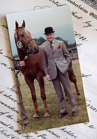 BNPS.co.uk (01202 558833)<br /> Pic: PhilYeomans/BNPS<br /> <br /> Like the Queen, Thomas was keen on the horses.<br /> <br /> A remarkable 'timewarp' archive amassed by a dressmaker to the Queen has sold for over £100,000.<br /> <br /> The late Ian Thomas meticulously kept his fashion designs, letters, cards and photographs relating to the Queen at his home that was more like a museum. <br /> <br /> He helped design the Queen's coronation gown in 1953 as well as the powder blue outfit she wore for Charles and Diana's wedding in 1981.<br /> <br /> The lifelong bachelor passed away in 1993 and left his home and its contents to a florist he had been good friends with for 25 years.<br /> <br /> After she died in 2015 the property was inherited by a relative who also knew Mr Thomas well.<br /> <br /> She has now sold the contents at auction.