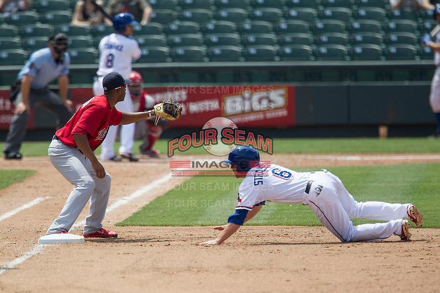 Round Rock Express outfielder Ryan Strausborger #6 dives back to first base as Memphis Redbirds first baseman Xavier Scruggs #16 waits for the pickoff throw during the Pacific Coast League baseball game on April 27, 2014 at the Dell Diamond in Round Rock, Texas. The Express defeated the Redbirds 6-2. (Andrew Woolley/Four Seam Images)