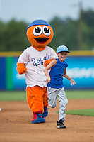 "A young fan races the Burlington Royals mascot ""Bingo"" around the bases between innings of the game against the Danville Braves at Burlington Athletic Park on July 12, 2015 in Burlington, North Carolina.  The Royals defeated the Braves 9-3. (Brian Westerholt/Four Seam Images)"