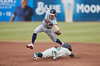 Cody Milligan (55) of the Rome Braves reaches for a wide throw as Fabricio Macias (25) of the Greensboro Grasshoppers steals second base at First National Bank Field on May 16, 2021 in Greensboro, North Carolina. (Brian Westerholt/Four Seam Images)