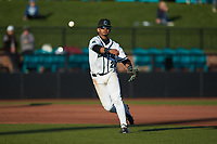 Coastal Carolina Chanticleers third baseman Eric Brown (20) makes a throw to first base against the Illinois Fighting Illini at Springs Brooks Stadium on February 22, 2020 in Conway, South Carolina. The Fighting Illini defeated the Chanticleers 5-2. (Brian Westerholt/Four Seam Images)