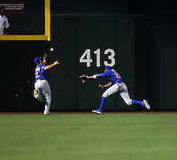 Kyle Schwarber (left)  collided with Dexter Fowler (right) of the Chicago Cubs attempting to make a catch of a flyball by Jean Segura of the Arizona Diamondbacks in the second inning of a game at Chase Field on April 7, 2016 in Phoenix, Arizona. Segura circled the bases for an inside-the-park homerun. Schwarber had to be removed from the game and is awaiting the results of an MRI  (Bill Mitchell)
