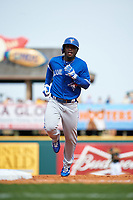 Toronto Blue Jays center fielder Roemon Fields (67) runs the bases after hitting a home run during a Spring Training game against the Pittsburgh Pirates on March 3, 2016 at McKechnie Field in Bradenton, Florida.  Toronto defeated Pittsburgh 10-8.  (Mike Janes/Four Seam Images)