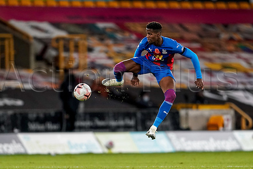 30th October 2020; Molineux Stadium, Wolverhampton, West Midlands, England; English Premier League Football, Wolverhampton Wanderers versus Crystal Palace; Wilfried Zaha of Crystal Palace tries to control the ball in the air
