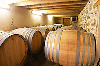 The barrel aging cellar with large oak barrels (demi muids) containing 600 litres as opposed to the usual size of 225 l.  Domaine du Colombier, Crozes-Hermitage, Mercurol, Drome Drôme, France Europe