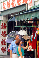 Touist retired couple shopping in Singapor