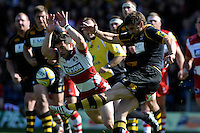 Jonny May of Gloucester Rugby attempts to charge down the clearance kick of Nick Robinson of London Wasps during the Aviva Premiership match between London Wasps and Gloucester Rugby at Adams Park on Sunday 1st April 2012 (Photo by Rob Munro)