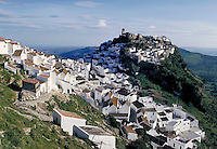 "Little white houses are built atop green hills like sprinkled grains of sugar. These groups of houses, known as """"white villages"""" are a favorite attraction found in southern Spain. Caceres, Spain."