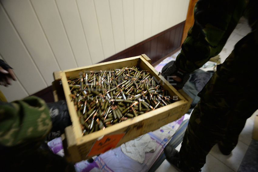Pro-Russian militia replace Ukrainian flags and recollect abandoned guns and and ammunitions at the Mirniy Border guard.