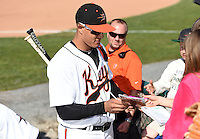 Baltimore Orioles third baseman Manny Machado (31) on rehab assignment with the Frederick Keys signs autographs after a game against the Carolina Mudcats on April 26, 2014 at Harry Grove Stadium in Frederick, Maryland.  Carolina defeated Frederick 4-2.  (Mike Janes/Four Seam Images)