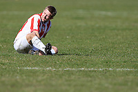 A Bancroft United FC player is seen holding his injured ankle during a Hackney & Leyton Sunday League match at Hackney Marshes - 15/03/09 - MANDATORY CREDIT: Gavin Ellis/TGSPHOTO - Self billing applies where appropriate - Tel: 0845 094 6026