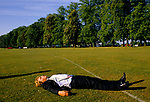 DRUNK LYING PASSED OUT ON THE PLAYING FIELDS AT THE CIRENCESTER ROYAL AGRICULTURAL COLLEGE BALL, 1990 UK