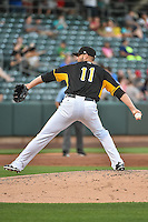Steven Hensley (11) of the Salt Lake Bees delivers a pitch to the plate against the Las Vegas 51s in Pacific Coast League action at Smith's Ballpark on June 25, 2015 in Salt Lake City, Utah. Las Vegas defeated Salt Lake 20-8.  (Stephen Smith/Four Seam Images)