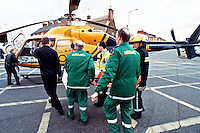 Paramedic ambulance crew and firefighters with police air ambulance helicopter attending to a casualty. They have just unloaded the casualty from the ambulance and are preparing to load him into the helicopter...© SHOUT. THIS PICTURE MUST ONLY BE USED TO ILLUSTRATE THE EMERGENCY SERVICES IN A POSITIVE MANNER. CONTACT JOHN CALLAN. Exact date unknown.john@shoutpictures.com.www.shoutpictures.com...