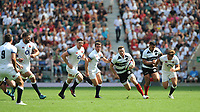 Chris Ashton (Toulon & England) of Barbarians breaks through the England defence during the Quilter Cup match between England and Barbarians at Twickenham Stadium on Sunday 27th May 2018 (Photo by Rob Munro/Stewart Communications)