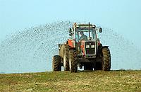 Spreading slurry with a slurry tanker, Cumbria...Copyright..John Eveson, Dinkling Green Farm, Whitewell, Clitheroe, Lancashire. BB7 3BN.01995 61280. 07973 482705.j.r.eveson@btinternet.com.www.johneveson.com