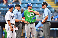 Asheville Tourists manager Warren Schaeffer (13), home plate umpire Mike Snover, Lexington Legends manager Scott Thorman (35) and first base umpire Emil Jimenez discuss ground rules before a game between the Lexington Legends and Asheville Tourists at McCormick Field on May 29, 2017 in Asheville, North Carolina. The Legends defeated the Tourists 6-2. (Tony Farlow/Four Seam Images)