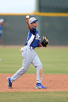 Los Angeles Dodgers shortstop Moises Perez (57) warms up during an Instructional League game against the Cleveland Indians on October 7, 2013 at Goodyear Training Complex in Goodyear, Arizona.  (Mike Janes/Four Seam Images)