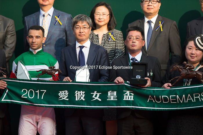 SHA TIN,HONG KONG-APRIL 30: The connestions (Joao Moreira (the jockey,left) and Noriyuki Hori (the trainer,second from left) and etc,) of Neorealism are celebrated after winning the Audemars Piguet QEII Cup at Sha Tin Racecourse on April 30,2017 in Sha Tin,New Territories,Hong Kong (Photo by Kaz Ishida/Eclipse Sportswire/Getty Images)