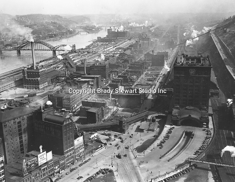 Pittsburgh PA:  View of uptown and Penn Station from the new Koppers Building.  For only a few years, Penn Station had a Pennsylvania Railroad sign on the side of the building. Strip District of Pittsburgh in the background.