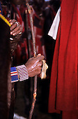 Lolgorian, Kenya. Moran warrior's hand with staff wearing piece of hide of a sacrificed cow as a finger ring. Eunoto ceremony.