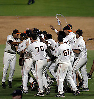 The AZL Giants celebrate on the field after defeating the Angels, 4-3, in a game at Scottsdale Stadium for the Arizona League 2009 East Division championship - 08/30/2009. The Giants will face the Mariners in Scottsdale for the league championship on 8/31/2009..Photo by:  Bill Mitchell/Four Seam Images..