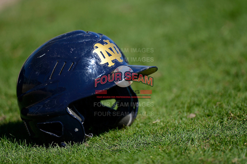 Notre Dame Fighting Irish batting helmet on the field after a game against the Mercer Bears at the Buck O'Neil Complex on February 17, 2013 in Sarasota, Florida.  Mercer defeated Notre Dame 5-4.  (Mike Janes/Four Seam Images)