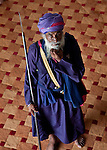 """June 21 2012, New Delhi, India:   A Sikh guard wanders the halls of Gurudwara Bangla Sahib. The temple is the most prominent Sikh gurdwara, or Sikh house of worship, in Delhi, known for its association with the eighth Sikh Guru, Guru Har Krishan, and the pond inside its complex, known as the """"Sarovar"""", whose water is considered holy by Sikhs and is known as """"Amrit"""". It was built by Sikh General, Sardar Bhagel Singh in 1783, who supervised the construction of nine Sikh shrines in Delhi in the same year, during the reign of Mughal Emperor, Shah Alam        Picture by Graham Crouch/Holland Herald"""