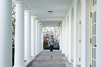 First Lady Melania Trump at the White House<br /> <br /> First Lady Melania Trump walks along the Colonnade of the White House Thursday, Dec. 17, 2020, en route to the Residence. (Official White House Photo by Andrea Hanks)