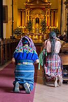 Antigua, Guatemala.  Women Kneeling in Church of San Jose, formerly Santiago.