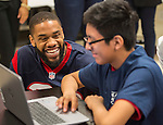Houston Texans defensive back Kurtis Drummond talks with a student during the Houston launch of the Character Playbook, a joint initiative of the NFL and the United Way Worldwide at Pilgrim Academy, February 3, 2017.