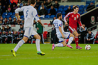 Wednesday 4th  December 2013 Pictured: Gareth Bale ( Left ) Takes the ball forwards for Wales<br /> Re: UEFA European Championship Wales v Cyprus at the Cardiff City Stadium, Cardiff, Wales, UK