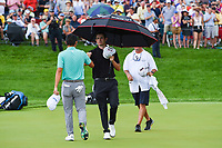 6th June 2021; Dublin, Ohio, USA; Collin Morikawa (USA) shakes hands with Patrick Cantlay (USA) in the rain on 18 during the Memorial Tournament final round at Muirfield Village Golf Club
