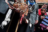"""A native from the Kamentsá tribe holds a rooster's body without a head during a ritual of the Carnival of Forgiveness, a traditional indigenous celebration in Sibundoy, Colombia, 12 February 2013. Clestrinye (""""Carnaval del Perdón"""") is a ritual ceremony kept for centuries in the Valley of Sibundoy in Putumayo (the Amazonian department of Colombia), a home to two closely allied indigenous groups, the Inga and Kamentsá. Although the festival has indigenous origins, the Catholic religion elements have been introduced and merged with the shamanistic tradition. Celebrating annually the collaboration, peace and unity between tribes, they believe that anyone who offended anyone may ask for forgiveness this day and all of them should grant pardons."""