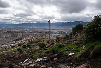 BOGOTA - COLOMBIA, 17-05-2020: Bandera roja, símbolo del hambre en tiempos de pandemia, izada sobre los escombros de las viviendas desalojadas y tumbadas por la retroexcavadora. Mas de 200 familias terminan el proceso de desalojo en el predio La Estancia al sur de Bogotá quedando sin ninguna ayuda ni un techo donde vivir durante la cuarentena total en el territorio colombiano causada por la pandemia  del Coronavirus, COVID-19. / Red flag, symbol of hunger in times of pandemic, hoisted over the rubble of the evicted houses and knocked down by the backhoe. More than 200 families are evicted from La Estancia farm at south of Bogota city and they left withoput any help and shelter to live during total quarantine in Colombian territory caused by the Coronavirus pandemic, COVID-19. Photo: VizzorImage / Mariano Vimos / Cont