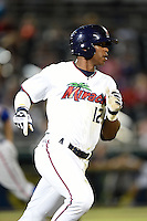 Fort Myers Miracle outfielder Adam Brett Walker II (12) runs to first during a game against the St. Lucie Mets on April 18, 2014 at Hammond Stadium in Fort Myers, Florida.  St. Lucie defeated Fort Myers 15-9.  (Mike Janes/Four Seam Images)