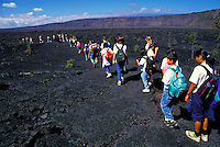 EDITORIAL ONLY. Schoolchildren hike through Kilauea Volcano Crater at Hawaii Volcanoes National Park