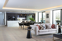 BNPS.co.uk (01202) 558833<br /> Pic: Savills/BNPS<br /> <br /> The home is open plan<br /> <br /> A striking high-tech eco home that would not look out of place in a Bond film is on the market for offers over £4m.<br /> <br /> Skyfall is a luxurious house in the Berkshire countryside designed to be totally carbon free.<br /> <br /> With its luxe white interiors, minimalist decor and stunning countryside surroundings, the five-bedroom property would fit effortlessly into 007's world.<br /> <br /> But it's the eco features of the brand new house, which is just outside the village of Taplow with Huntswood Golf Course next door, that make it really stand out.