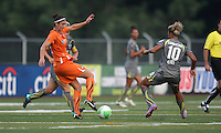 Sky Blue midfielder, Yael Averbuch (13), turns the ball away from the challenge of Philadelphia forward, Lianne Sanderson (10).  The Philadelphia Independence scored three first half goals, and went on to win 4-1 over Sky Blue at John A Farrell Stadium in West Chester, Pennsylvania.