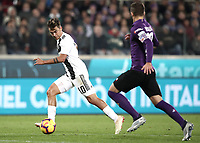 Calcio, Serie A: Fiorentina - Juventus, stadio Artemio Franchi Firenze 1 dicembre 2018.<br /> Juventus'  Paulo Dybala (l) in action with Fiorentina's captain German Pezzella (r) during the Italian Serie A football match between Fiorentina and Juventus at Florence's Artemio Franchi stadium, December 1, 2018.<br /> UPDATE IMAGES PRESS/Isabella Bonotto