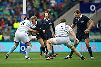 Alex Waddingham of Oxford University  is tackled by Stuart Brown (left) and Nate Brakeley of Cambridge University during the 131st Varsity Match between Oxford University and Cambridge University at Twickenham on Thursday 06 December 2012 (Photo by Rob Munro)