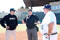 CARY, NC - FEBRUARY 23: Head coach Jim Carrone of Wagner College and head coach Rob Cooper of Penn State University listen to the home plate umpire during a game between Wagner and Penn State at Coleman Field at USA Baseball National Training Complex on February 23, 2020 in Cary, North Carolina.
