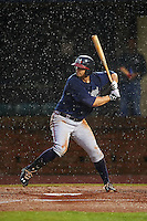 Mississippi Braves first baseman Seth Loman (22) at bat in the rain during a game against the Mobile BayBears on April 28, 2015 at Hank Aaron Stadium in Mobile, Alabama.  The game was suspended after the top of the second inning with Mobile leading 3-0, the BayBears went on to defeat the Braves 6-1 the following day.  (Mike Janes/Four Seam Images)