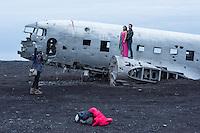Wreck of a Douglas R4D-8 / Super DC-3 at the beach of Solheimasandur.<br /> The airplane of the US-Navy make a forced landing 21.11.1973.<br /> Here: A couple is posing for Honey Moon-pictures.<br /> Wrack einer Douglas R4D-8 vom Typ Super DC-3 am Strand von Solheimasandur in Island.<br /> Die Maschine der US-Navy ist wegen Spirtmangel am 21. November 1973 am Strand von Solheimasandur notgelandet. Mittlerweile ist nur noch ein Teil des Rumpfes vorhanden.<br /> Im Bild: Ein Paar laesst sich in seinen Flitterwochen fotografieren.<br /> 17.3.2016, Solheimasandur<br /> Copyright: Christian-Ditsch.de<br /> [Inhaltsveraendernde Manipulation des Fotos nur nach ausdruecklicher Genehmigung des Fotografen. Vereinbarungen ueber Abtretung von Persoenlichkeitsrechten/Model Release der abgebildeten Person/Personen liegen nicht vor. NO MODEL RELEASE! Nur fuer Redaktionelle Zwecke. Don't publish without copyright Christian-Ditsch.de, Veroeffentlichung nur mit Fotografennennung, sowie gegen Honorar, MwSt. und Beleg. Konto: I N G - D i B a, IBAN DE58500105175400192269, BIC INGDDEFFXXX, Kontakt: post@christian-ditsch.de<br /> Bei der Bearbeitung der Dateiinformationen darf die Urheberkennzeichnung in den EXIF- und  IPTC-Daten nicht entfernt werden, diese sind in digitalen Medien nach §95c UrhG rechtlich geschuetzt. Der Urhebervermerk wird gemaess §13 UrhG verlangt.]