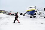 LaQuinton Ross walks to the plane